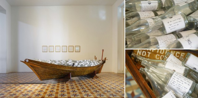 Ahmad Abu Bakar, Telok Blangah, 2013, Paint, varnish, glass bottles, decals and traditional wooden boat. Approx. 300 x 450 cm.
