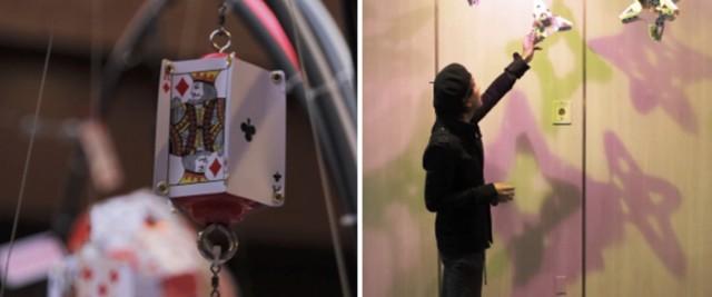 左) ハート型フレームに取り付けられた、音が鳴る仕掛け(「音具」)。幼児用玩具「ガラガラ」を素材に用い、風が吹いたり、フレームが揺れると、どこか懐かしい印象の音が聞こえてくる。右) 通路空間に展示された作品「光を求めてⅡ」の前で、色光による影の出具合を確認する志喜屋氏。